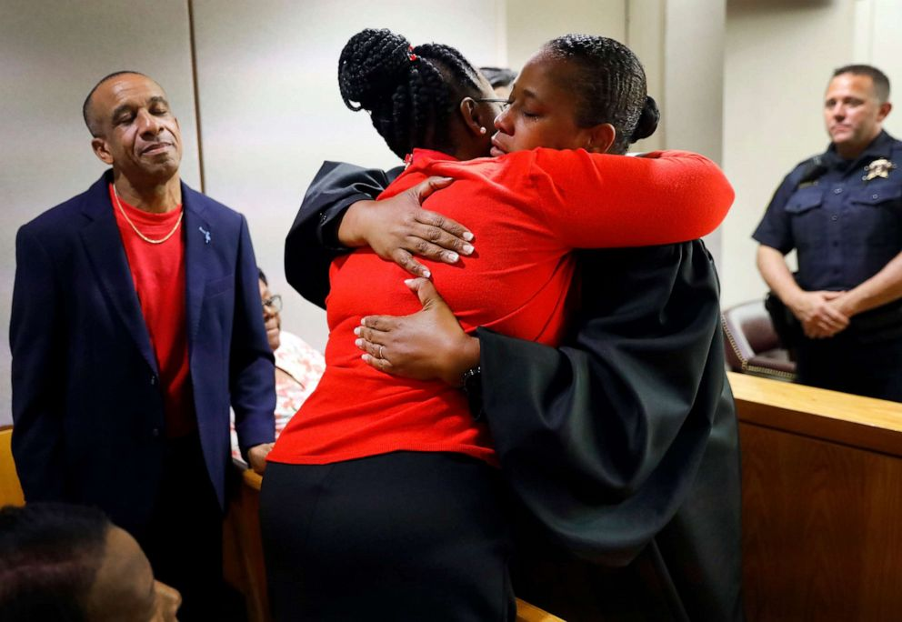 PHOTO: State District Judge Tammy Kemp, right, gives Botham Jeans mother, Allison Jean, a hug while Bothams father, Bertrum Jean, stands at left, following the 10-year sentence given to former Dallas Police Officer Amber Guyger, Oct. 2, 2019, in Dallas.
