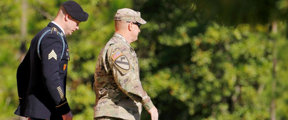 PHOTO: U.S. Army Sergeant Bowe Bergdahl, left, is escorted out of the courthouse after the sixth day of sentencing proceedings in his court martial at Fort Bragg, North Carolina, Nov. 1, 2017.