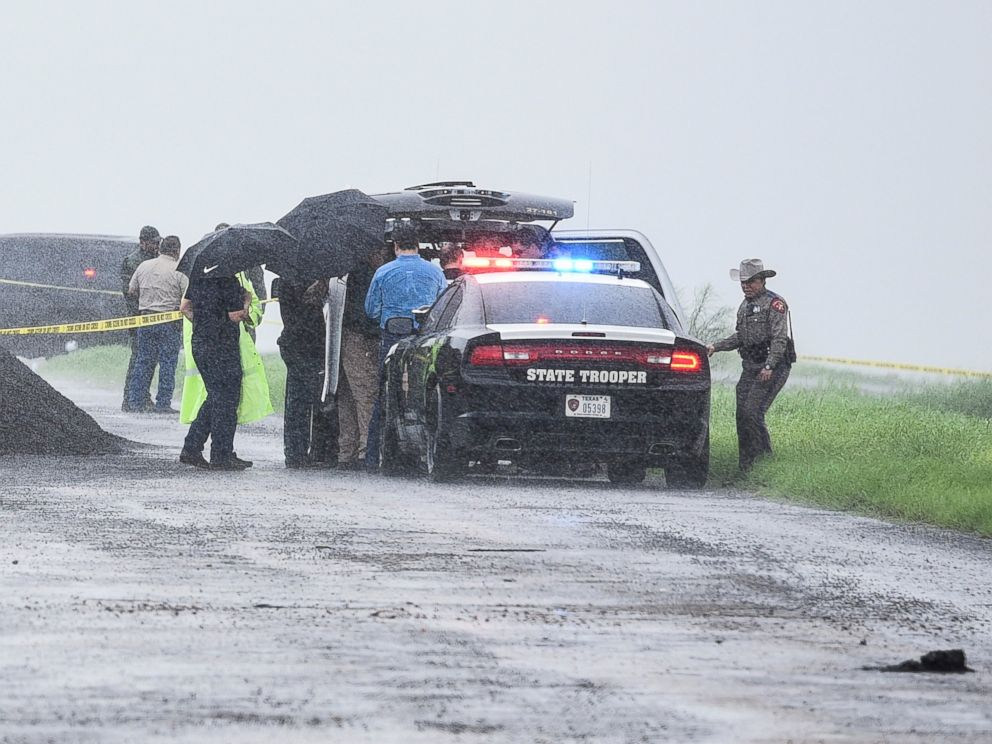 PHOTO: Law enforcement officers gather near the scene where the body of a woman was found near Interstate 35 north of Laredo, Texas on Saturday, Sept. 15, 2018.