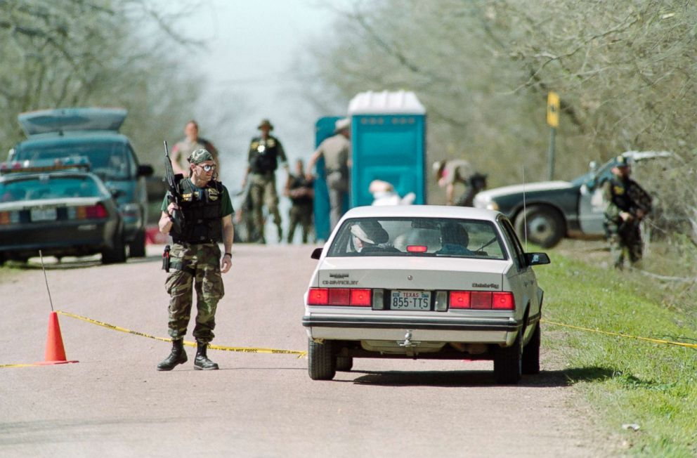 Bureau of Alcohol, Tobacco and Firearms agents confronts sightseers, March 8, 1993, at a checkpoint near the Branch Davidian religious compound in Texas.