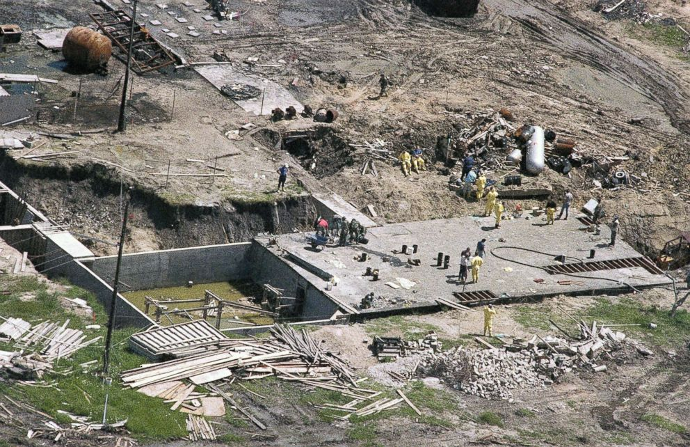 Investigators work on top of the underground bunker at the Branch Davidian compound near Waco, Texas, May 3, 1993, as the search continues for more bodies at the burned out compound.