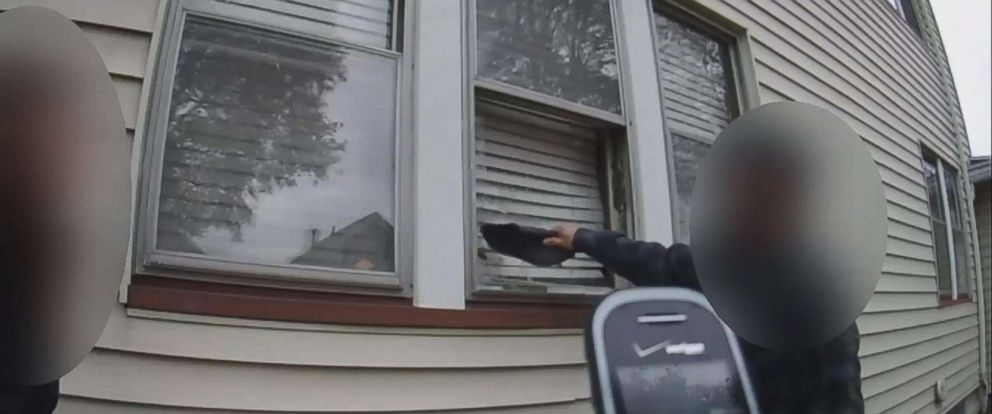 PHOTO: Bodycam footage appears to show a Rochester Police officer instructing a man to break into his ex-girlfriends home.