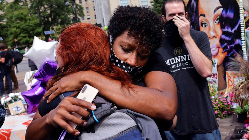 PHOTO: People react after a decision in the criminal case against police officers involved in the death of Breonna Taylor, who was shot dead by police in her apartment, in Louisville, Ky., Sept. 23, 2020.