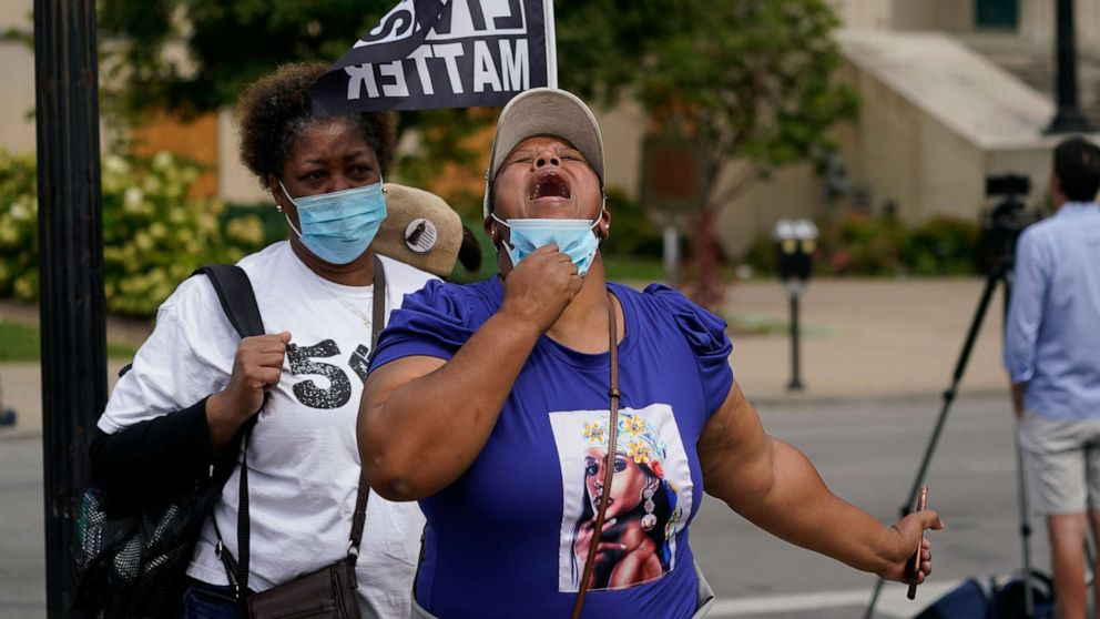 PHOTO: A woman reacts to news in the Breonna Taylor shooting, Sept. 23, 2020, in Louisville, Ky.