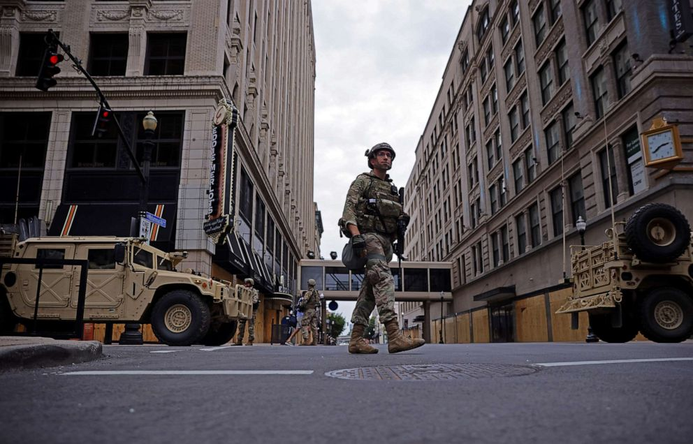 PHOTO: A member of the National Guard patrols the section of a downtown in Louisville, Ky., Sept. 23, 2020.