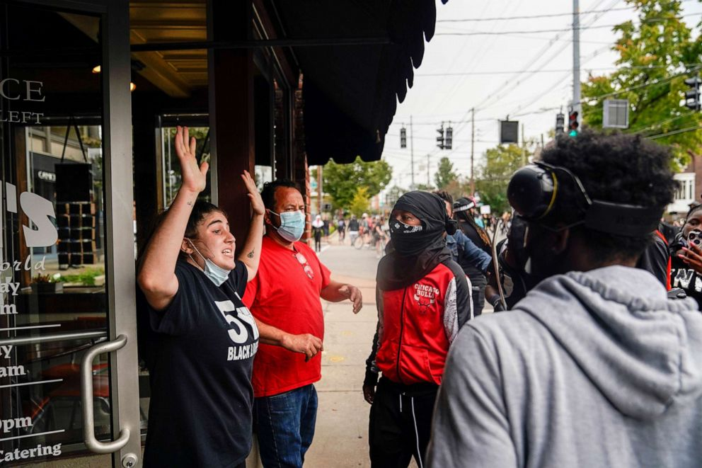 PHOTO: Business owners plead with demonstrators not to destroy their business, as people react after a decision in the criminal case against police officers involved in the death of Breonna Taylor, in Louisville, Ky., Sept. 23, 2020.