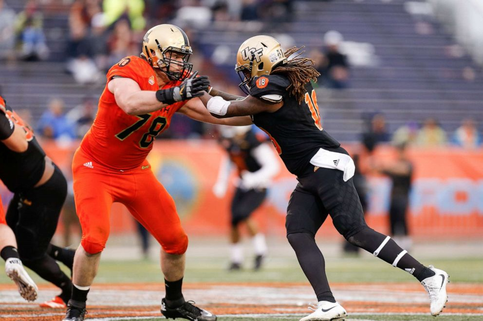 PHOTO: Linebacker Shaquem Griffin, right, is blocked by tackle Brett Toth during the 2018 Reeses Senior Bowl game at Ladd-Peebles Stadium, Jan. 27, 2018, in Mobile, Alabama.