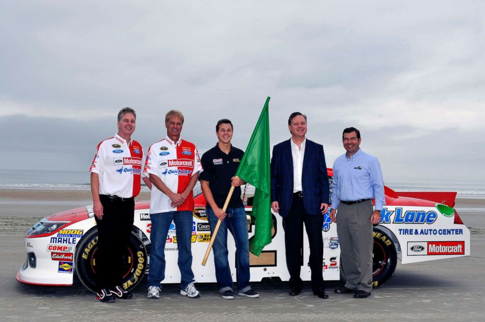 PHOTO: In this file photo, Len Wood, Eddie Wood, Joie Chitwood, Trevor Bayne and Brian France near the beach course famous North Turn prior to Trevor Bayne driving the car to the Daytona International Speedway, Feb. 19, 2012, in Daytona Beach, Fla.