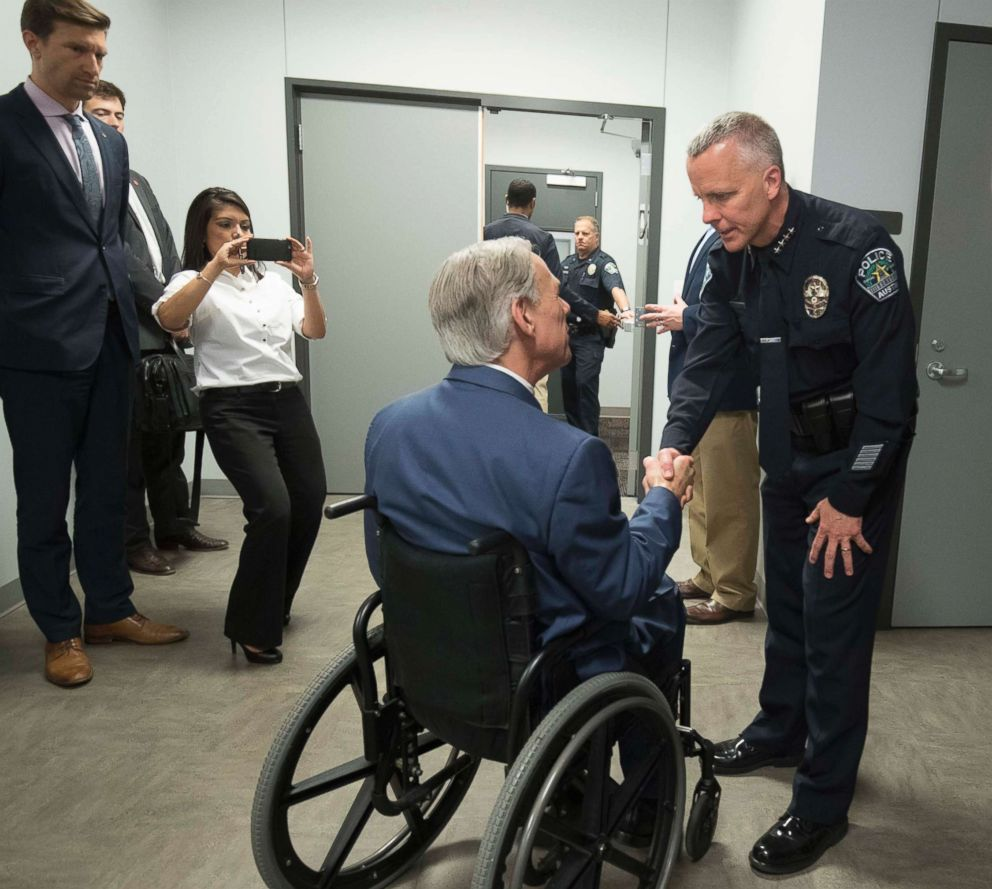 PHOTO:Austin Police Chief Brian Manley, right, shakes the hand of Gov. Greg Abbott of Texas as he leads a congratulatory press conference with the governor and others who assisted in bringing down the serial Austin bomber, March 21, 2018.