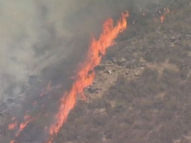 Extreme fire danger hits the West, coldest air of season strikes central US