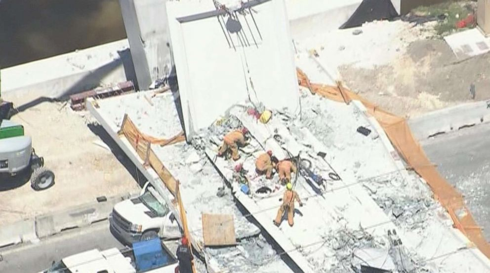 PHOTO: First responders were seen tending to injured victims on the scene of a pedestrian bridge that collapsed on the Florida International University campus in Miami, March 15, 2018.