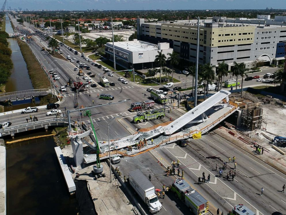 PHOTO: This photo provided by DroneBase shows the collapsed pedestrian bridge at Florida International University in Miami, March 15, 2018.