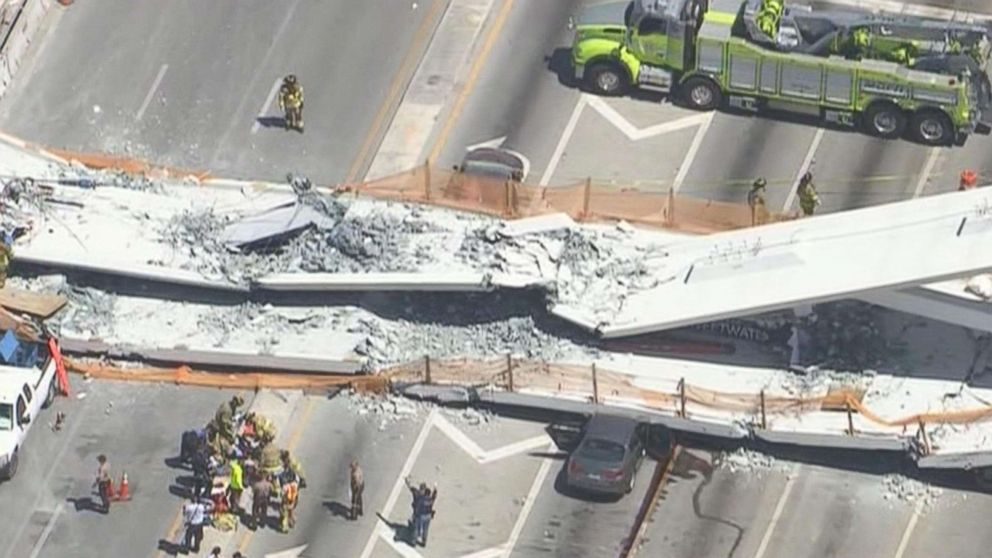First responders were seen tending to injured victims on the scene of a pedestrian bridge that collapsed on the Florida International University campus in Miami, March 15, 2018.