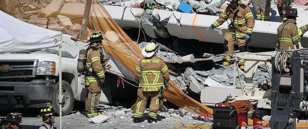 PHOTO: Miami-Dade Fire Rescue Department personnel and other rescue units work at the scene where a pedestrian bridge collapsed a few days after it was built on the Florida International University, March 15, 2018, in Miami.