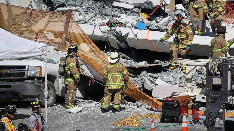 Miami-Dade Fire Rescue Department personnel and other rescue units work at the scene where a pedestrian bridge collapsed a few days after it was built over southwest 8th street allowing people to bypass the busy street to reach Florida International University, March 15, 2018, in Miami.