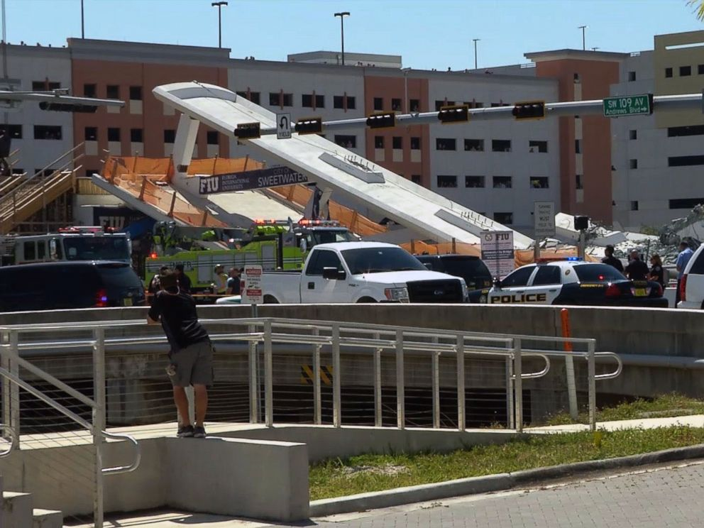 PHOTO: This AFP TV video frame grab shows a newly installed pedestrian bridge over a six-lane highway in Miami on the Florida International University in Miami, March 15, 2018, crushing a number of cars below.