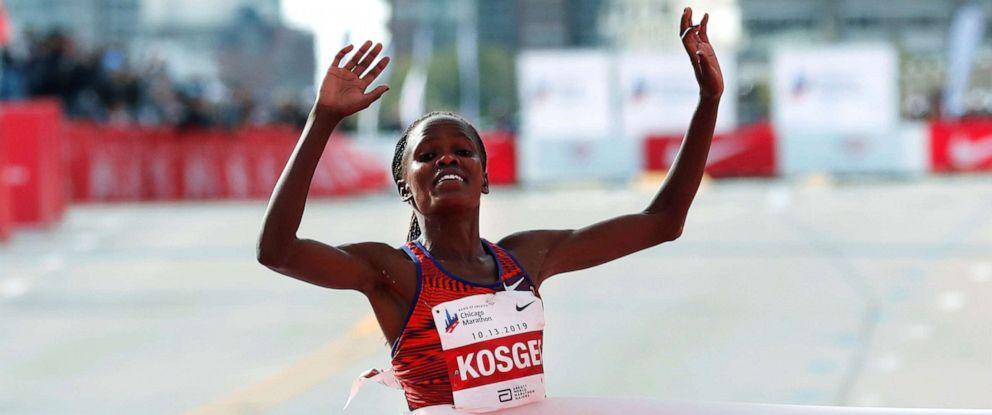 PHOTO: Kenyas Brigid Kosgei crosses the finish line winning the womens marathon and setting a new world record,at the Chicago Marathon, Oct. 13, 2019.