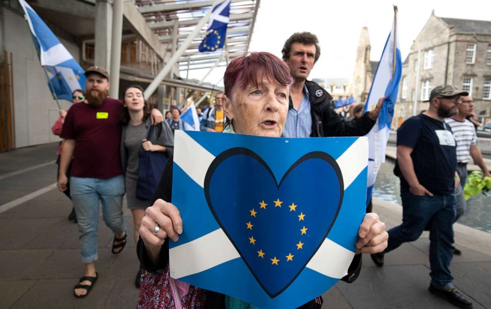 PHOTO: Protesters from the European Movement in Scotland hold a walking vigil outside the Scottish Parliament in Edinburgh to demonstrate against Prime Minister Boris Johnson proroguing Parliament, in Scotland, Aug. 28, 2019.