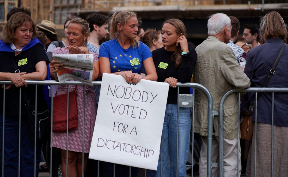 PHOTO: An anti-Brexit protester holds a placard outside the Houses of the Parliament in London, Aug. 28, 2019.