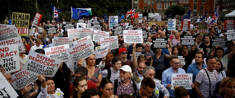 PHOTO: Anti-Brexit protesters hold placards outside the Houses of the Parliament in London, Aug. 28, 2019.