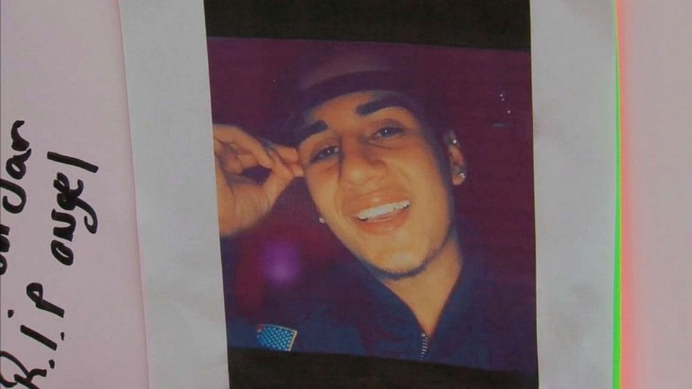 A photo of Angel Reyes-Godoy, 17, was left by a stoop where he used to hang out with his friends in the Bronx borough of New York, Dec. 11, 2018.