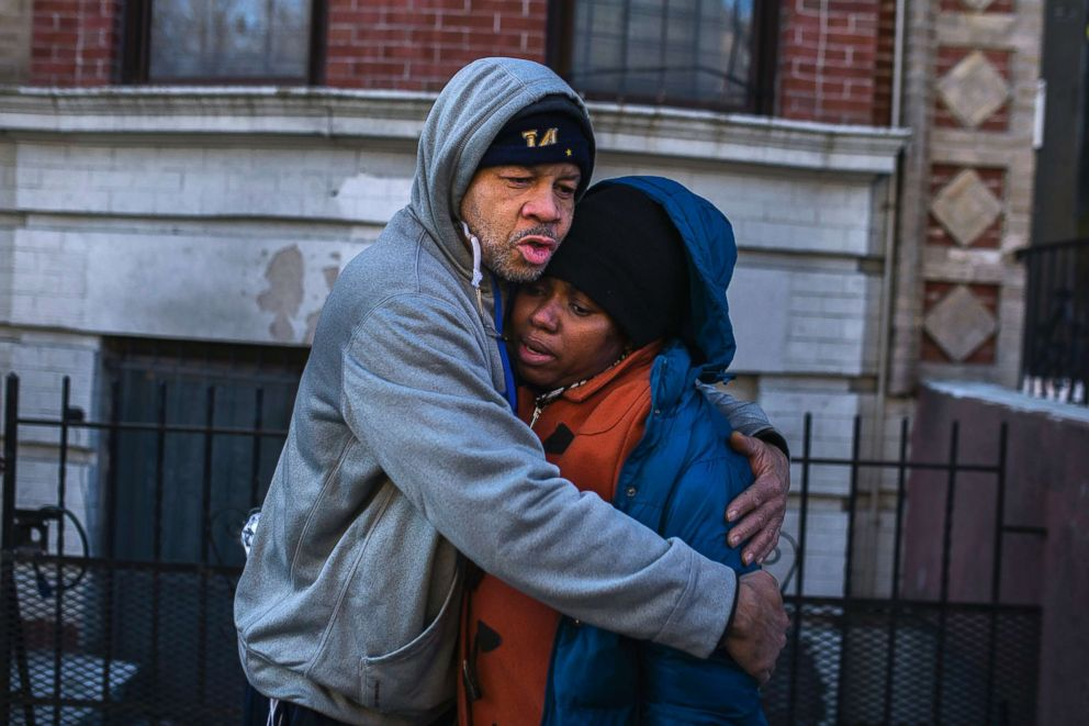 PHOTO: Emelia Ascheampong, right, a resident of the building where at least 12 people died in a fire, is embraced by a friend, Dec. 29, 2017, in the Bronx borough of New York. Ascheampong, her husband and four children, survived by using a fire escape.