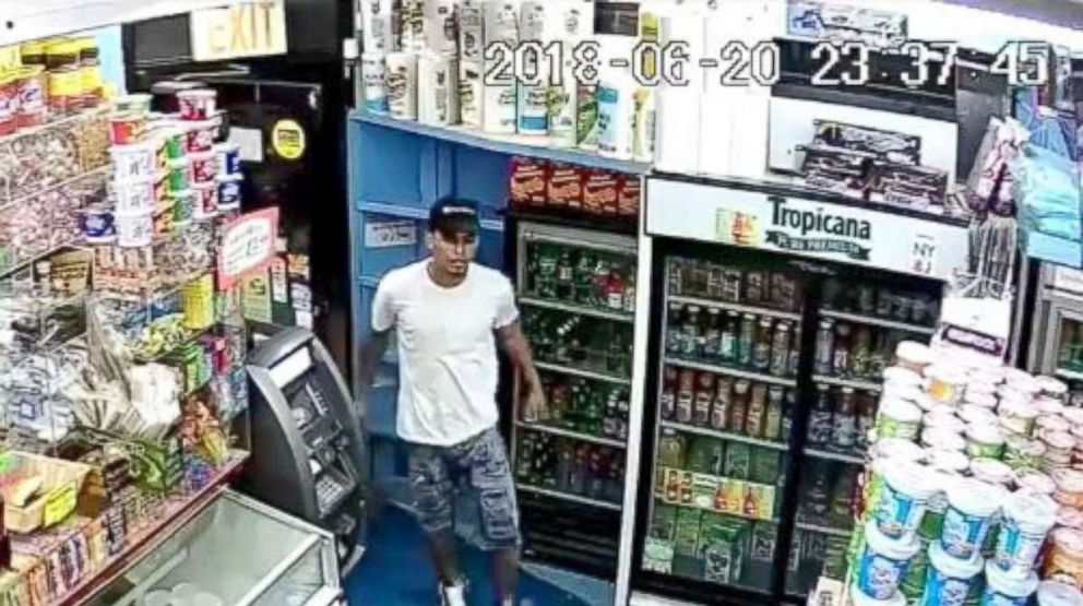 PHOTO: Police release a video surveillance showing a man in the white T-shirt as part of a group of men who allegedly hacked Lesandro Guzman-Feliz, 15, with a knife to death in the Bronx on June, 2018.