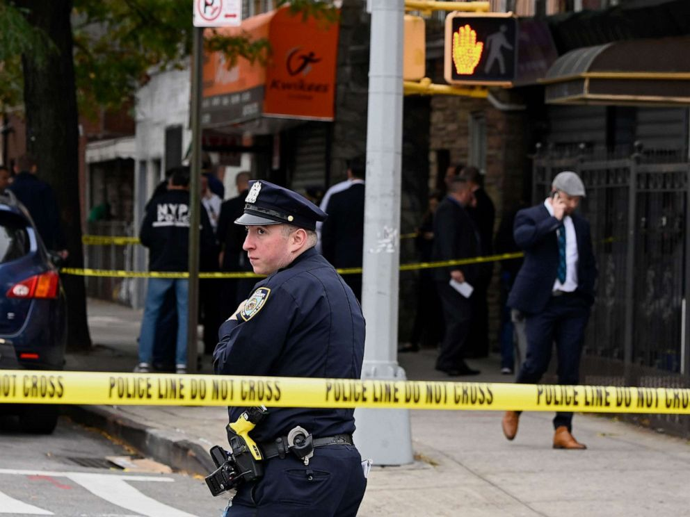PHOTO: New York police officers secure a crime scene outside a club after a shooting in Brooklyn on Oct. 12, 2019.