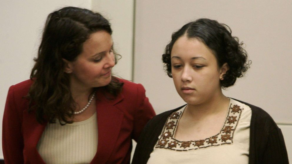 Wendy Tucker rubs Cyntoia Brown's back during closing arguments in her trial in Nashville, Tenn. Brown received a life sentence for the murder of Johnny Mitchell Allen, Aug. 25, 2006.