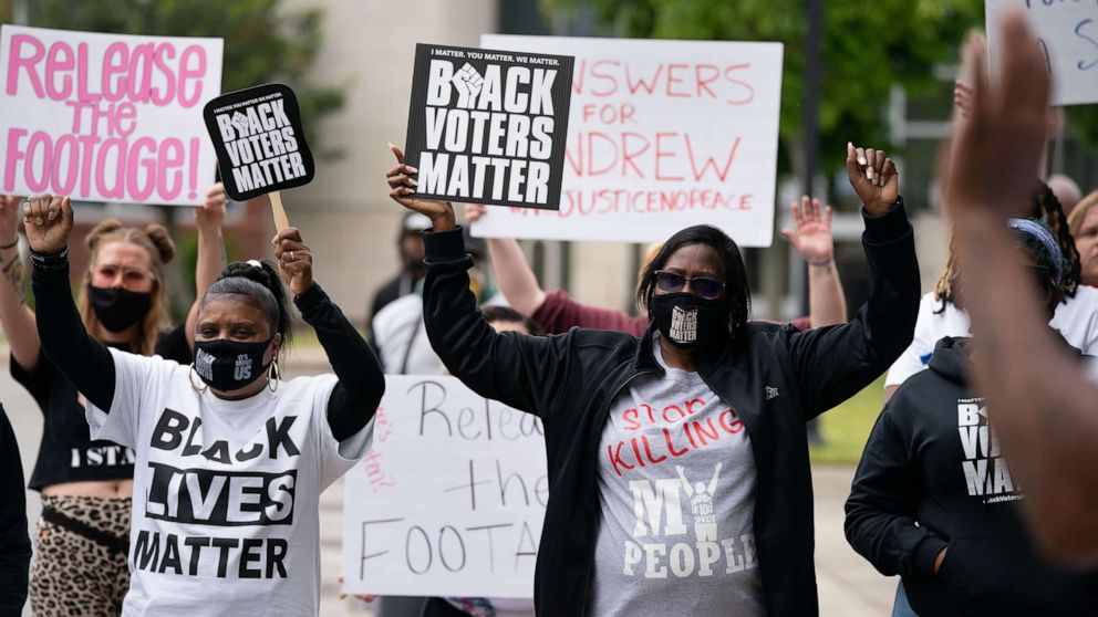 PHOTO: Demonstrators hold signs during a protest march, April 24, 2021, in Elizabeth City, N.C., calling for the release of body camera footage from the shooting death of Andrew Brown Jr., 3 days prior.