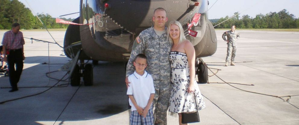 PHOTO: Army Chief Warrant Officer Bryan Nichols poses for a photo with his family in an undated handout photo.