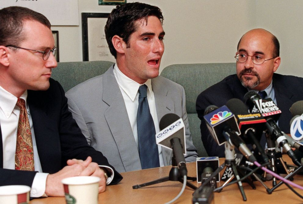 James Dale, center, a Matawan, N.J. assistant scoutmaster who was kicked out of the Boy Scouts nine years ago when leaders found out he is gay, is flanked by Evan Wolfson, Lambda Legal Defense and Education Fund senior staff attorney, right, and Lambda attorney David Buckel at a news conference, Aug. 4, 1999, at the New York offices of Lambda, which represented Dale in court.