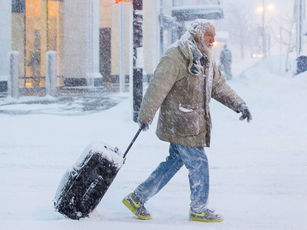 PHOTO: Man moves luggage in snow during a winter storm in Buffalo, N.Y., Jan. 30, 2019.