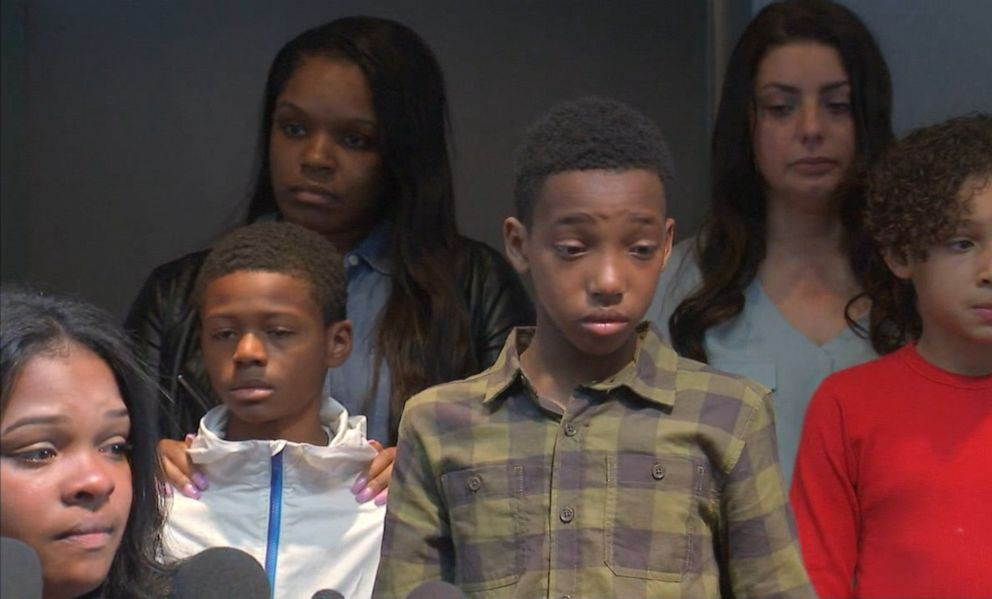 PHOTO: Friends and family members listen as Ashley Smith, lower left, talks about an allegedly racist incident at a Buffalo Wild Wings in Naperville, Ill., during a press conference on Nov. 5, 2019.