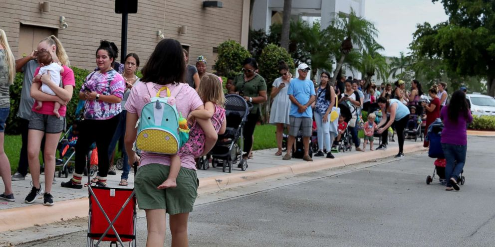 PHOTO: Parents and kids in line for close to an hour at Coral Square mall, for the Build-A-Bear Workshop Pay Your Age Day event, July 12, 2018.