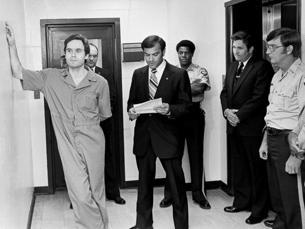 PHOTO: Suspected murderer Ted Bundy leans on the Leon County jail wall as an indictment charging him with the murders of two FSU coeds at the Chi Omega house is read by Leon County Sherriff Ken Katarsis in Tallahassee, Fla., July 27, 1978.