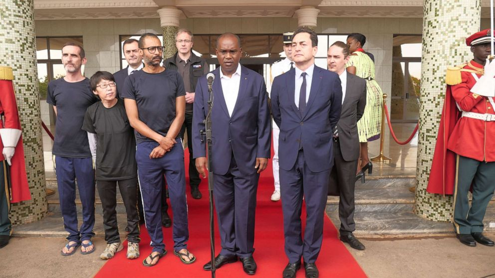 PHOTO:Burkina Fasos Foreign Minister Alpha Barry addresses media next to freed hostages during a presser following a meeting with Burkina Fasos President at Kosyam Presidential Palace in Ouagadougou, May 11, 2019.