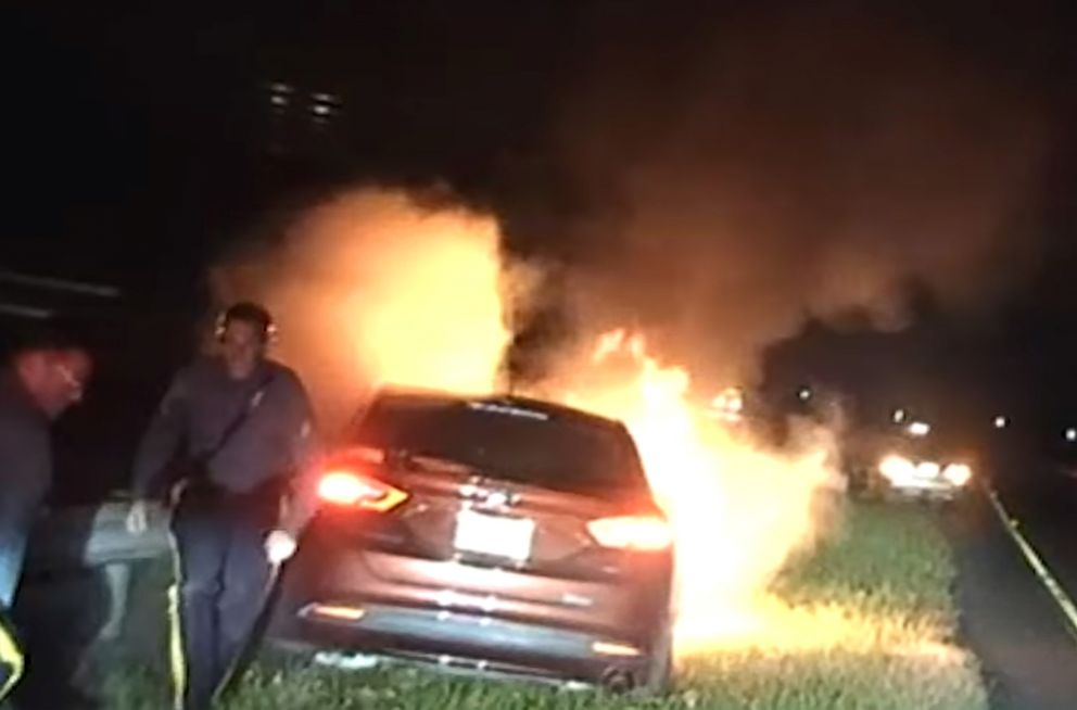 New Jersey State Troopers Thomas O'Connor and Christopher Warwick dragged an unconscious man from a burning car on the side of State Highway 42 in Camden County, Nov. 4, 2018.