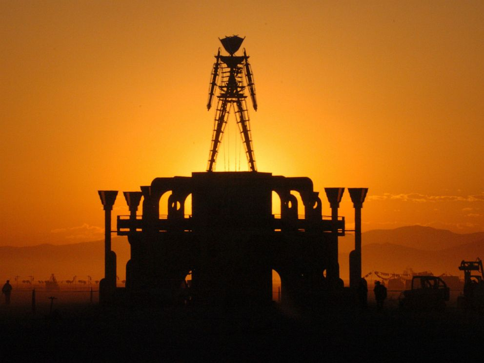 PHOTO: In this Sept. 2, 2006 file photo, The Man, a stick figured symbol of the Burning Man art festival, is silhouetted against a morning sunrise in Nevadas Black Rock Desert.