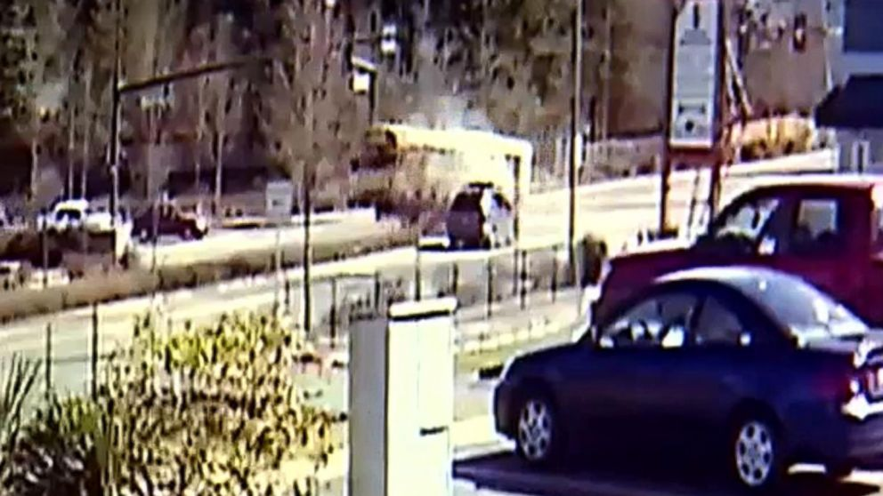 Surveillance video shows SUV colliding with school bus in