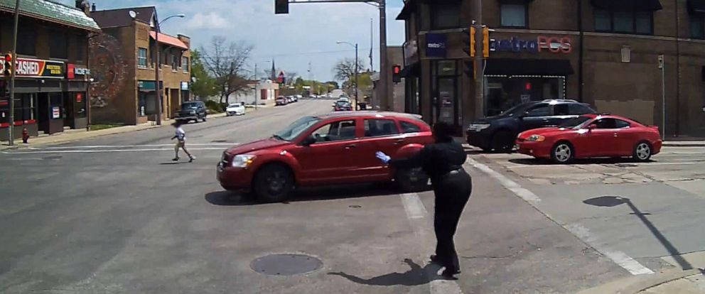 PHOTO: Milwaukee County Transit System (MCTS) driver Cecilia Nation-Gardner rushes into traffic to save six-year-old.