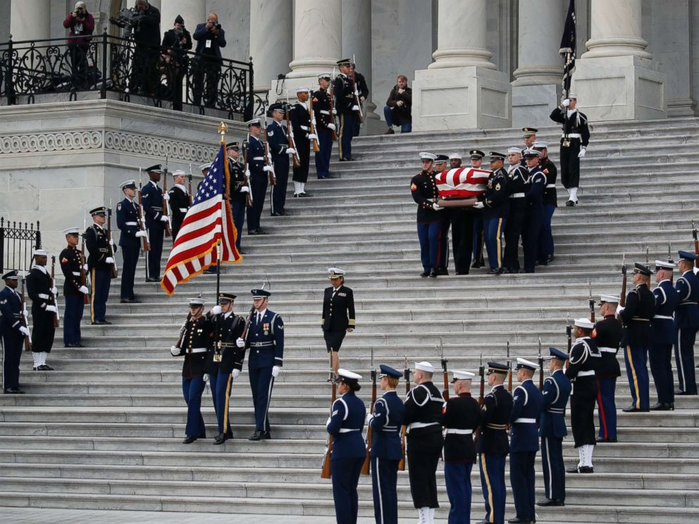 PHOTO: The flag-draped casket of former President George H.W. Bush is carried by a joint services military honor guard from the U.S. Capitol, Dec. 5, 2018, in Washington.