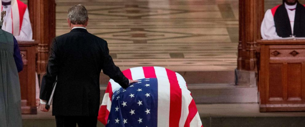 PHOTO: Former President George W.Bush touches the flag-draped casket of his father, as he prepares to speak during the funeral for former President George H.W. Bush at the National Cathedral, Dec. 5, 2018, in Washington, D.C.