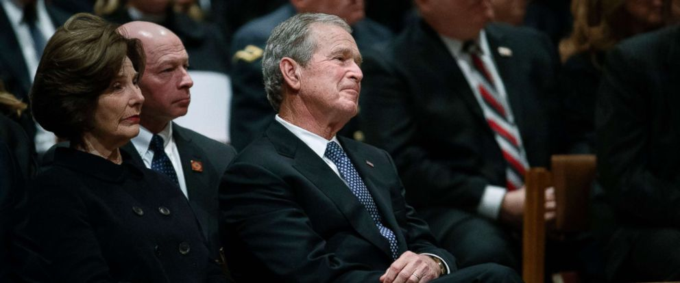 PHOTO: Former President George W. Bush and Laura Bush look on during the State Funeral for his father, former President George H.W. Bush, at the National Cathedral, Dec. 5, 2018, in Washington.