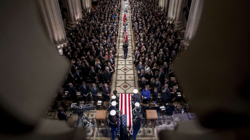 The flag-draped casket of former President George H.W. Bush arrives for a State Funeral at the National Cathedral, Dec. 5, 2018 in Washington, D.C.