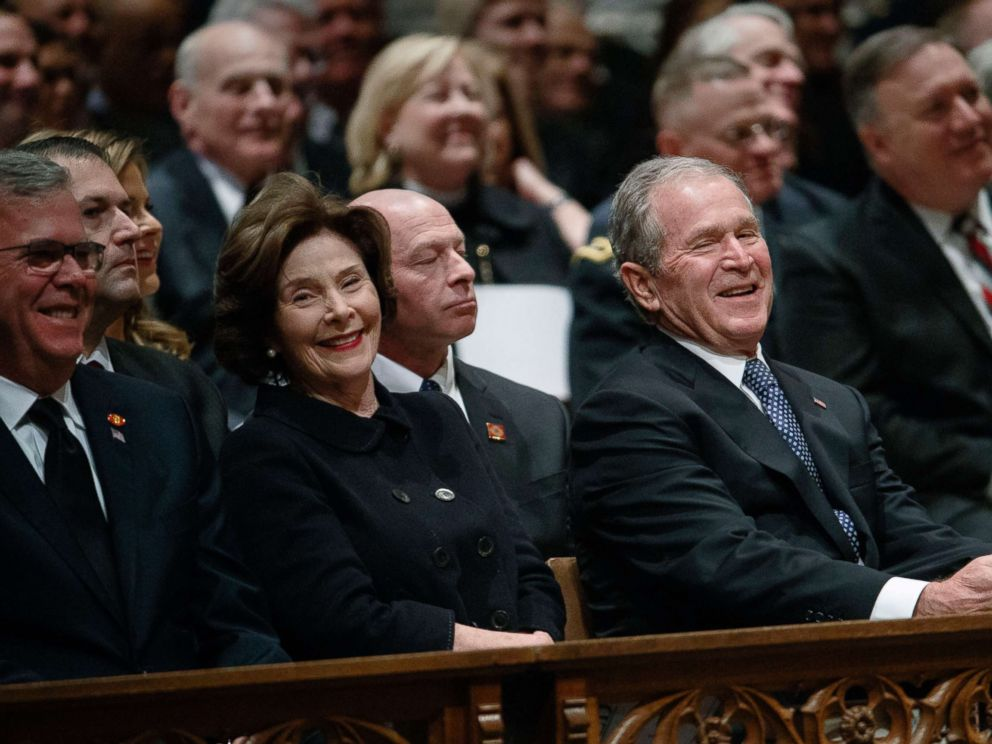 PHOTO: Jeb Bush, Laura Bush, and former President George W. Bush share a laugh as a story is told about former President George H.W. Bush during a State funeral at the National Cathedral, Dec. 5, 2018, in Washington.