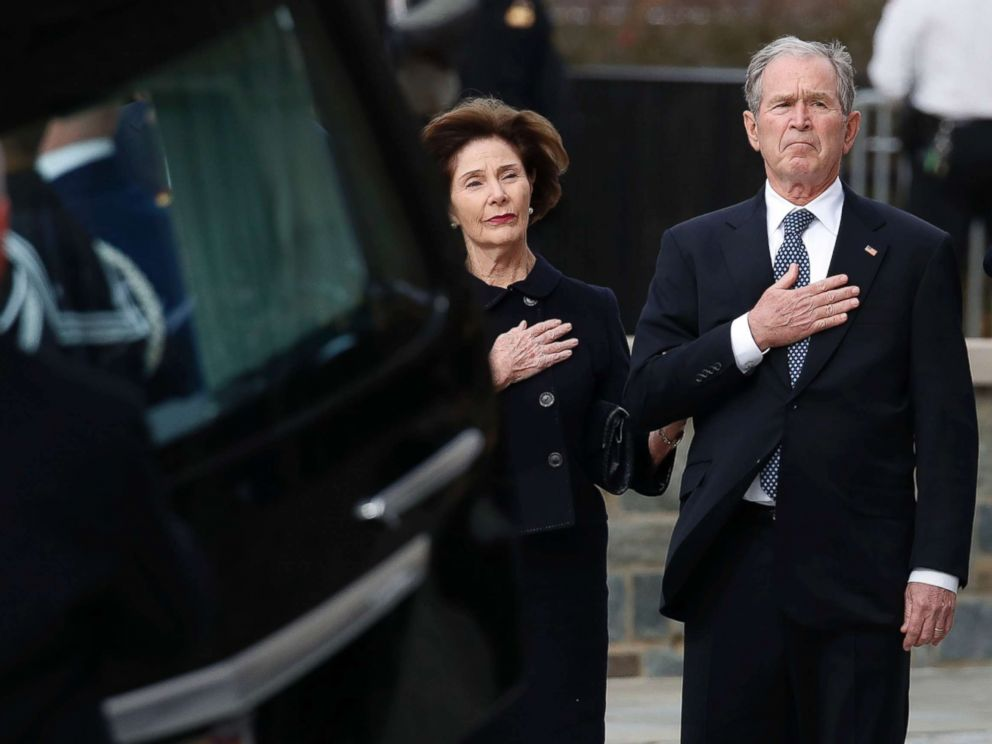 PHOTO: Former President George W. Bush and former first lady Laura Bush watch as the flag-draped casket of former President George H.W. Bush is carried to a State Funeral at the National Cathedral, Dec. 5, 2018 in Washington.