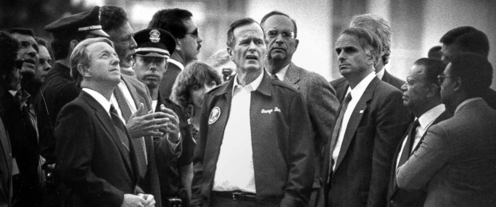 """PHOTO: President George H. W. Bush, exclaims """"Jesus"""" after viewing the collapsed Cypress Structure section of I-880 where the majority of victims died during the Loma Prieta earthquake, Oct. 20, 1989."""