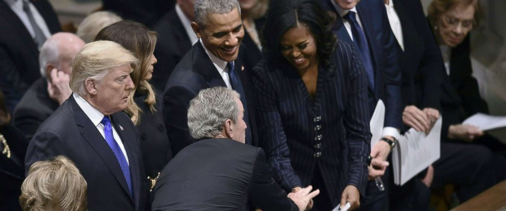 PHOTO: Former president George W. Bush reaches past President Donald Trump to greet former first Lady Michelle Obama during the funeral service for former President George H.W. Bush at the Washington National Cathedral, Dec. 5, 2018, Dec. 5, 2018.