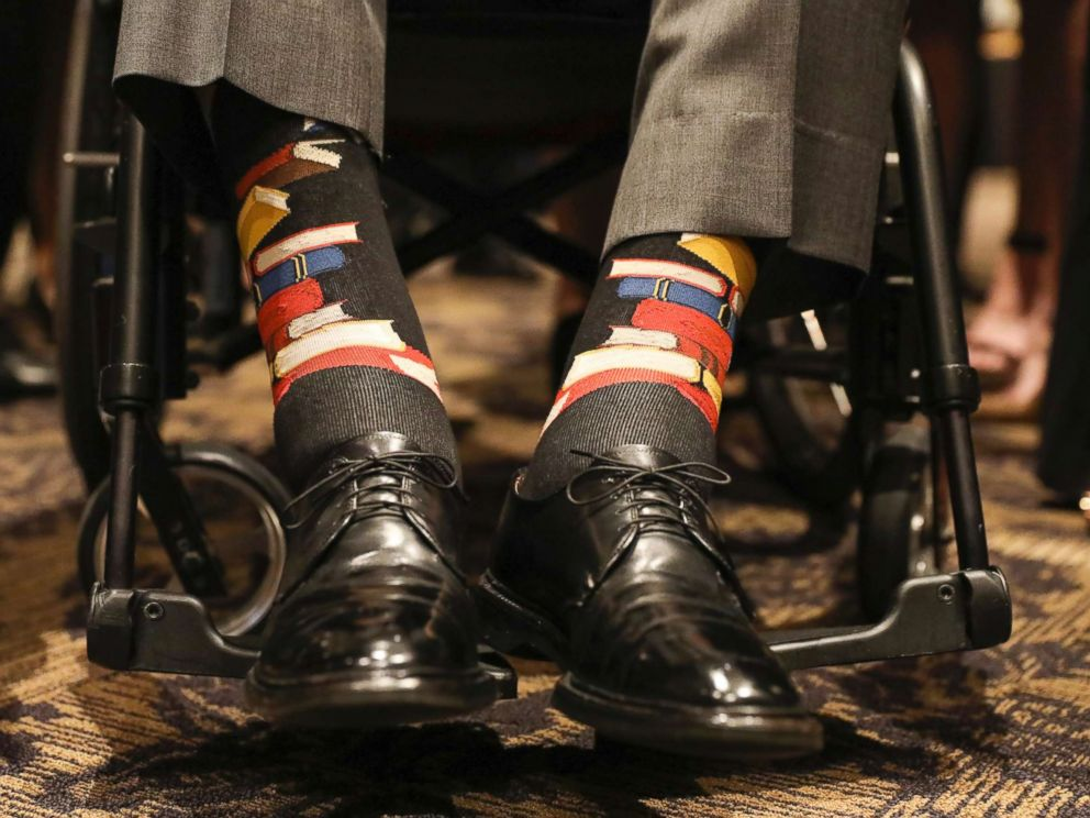 PHOTO: Former U.S. President George H.W. Bush wears socks printed with blue, red and yellow books during the funeral service for his wife, Barbara Bush, in Houston on April 21, 2018.